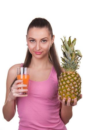 The girl holds pineapple