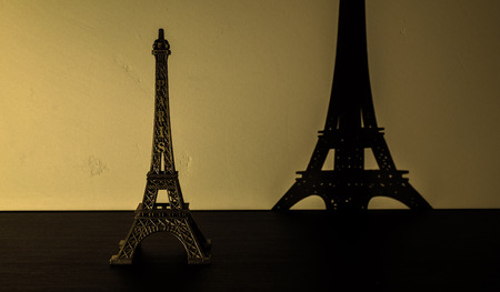 Metal object that represents Eiffel Tower. Picture can be used as a background for a brochure