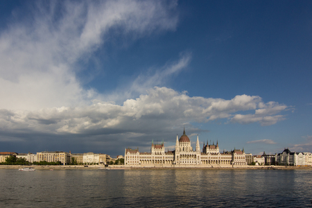 old hungarian parliament building across the Donau river in Budapest, Hungary Stock Photo