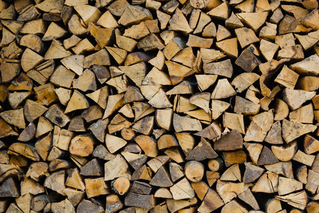 stack of firewood: stack of brown firewood logs