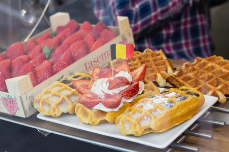 traditional sweet Belgian waffles with strawberries in the shop Stock Photo