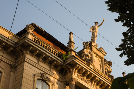 42nd: Statue of Mercury - a major Roman god standing on a building facade in city Lviv, Ukraine