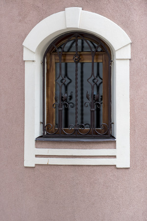 window grill: old style window with steel protection