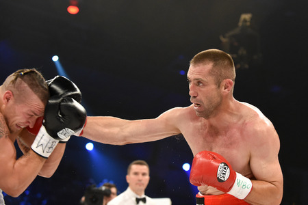 powerfull: Kyiv, UKRAINE - December 13, 2014 : Oleksandr Usyk (Ukraine) and South African Danie Venter in the ring during fight for WBO Inter-Continental cruiserweight title in the Palace of sport