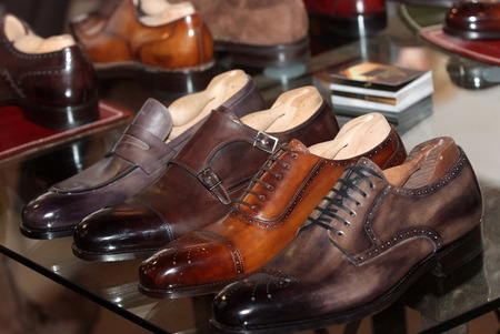 Set of black and brown mens luxury shoes in the store