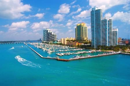 Jet ski and boat sailing next to South Miami Beach
