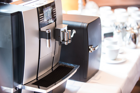 internet cafe: Professional coffee machine closeup with selective focus