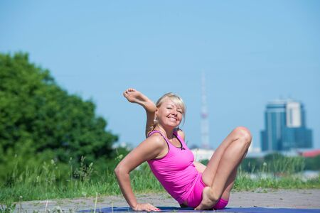 lifestile: Preatty young Woman doing yoga asanas in the park at sunny day