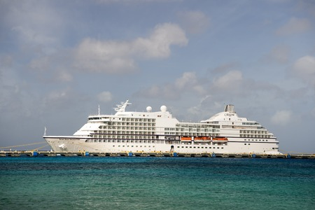 seas: Cozumel, Mexico - December 24, 2015: Large luxury cruise ship Seven Seas Navigator of Regent Seven Seas Cruise lines at the port of Cozumel