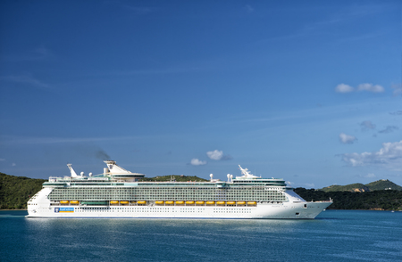 caribbean cruise: Philipsburg, St.Maarten, Netherlands-January 13, 2016: Royal Caribbean Cruise passenger ship Freedom of the seas sailing in bay of Philipsburg, st.Maarten at sunny day on blue water and clear sky background