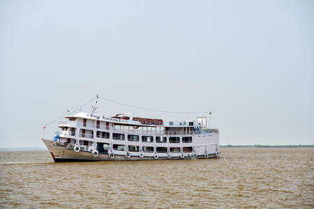 rio amazonas: Amazon river, Brazil-December 2, 2015: Anna Karolina small passenger boat in dirty water of Amazon river grey brown color on moody sky background Editorial