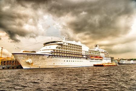 seas: Santarem, Brazil-December 24, 2015: Large luxury cruise ship Seven Seas Navigator anchored at sea at the port of Santarem, Brazil at cloudy day