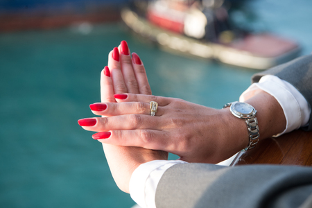 lady hand: Elegant female hands with Red nails manicure with jewels and watch
