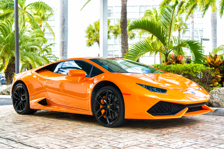 lamborghini: Miami, Florida, USA-February 19, 2016: Supercar Lamborghini Aventador orange color parked next to Ocean drive at South bech at Miami, Florida. Lamborghini is famous expensive automobile brand car