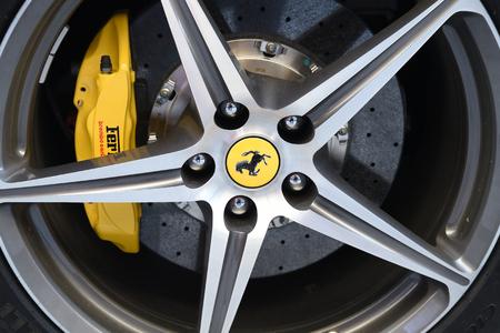 Hamburg, Germany - JUNE 14, 2016: Wheel of a white sports car Ferrari 458 Spider (since 2011). Ferrari is famous expensive automobile brand car