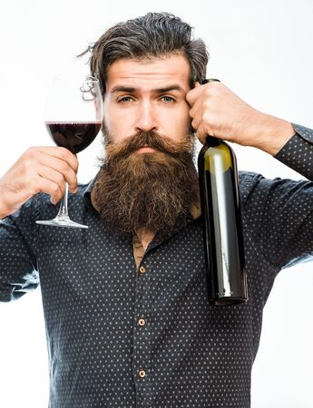 white beard: handsome bearded rich man with stylish hair mustache and long beard on serious face in blue fashion shirt holding glass of red wine and bottle isolated on white