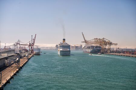 blue vessels: Barcelona, Spain - March 30, 2016: big ships or ocean liners marine vessels enter port on beautiful blue sea water on sunny day on seascape background