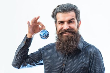 white beard: handsome bearded man with stylish hair mustache and beard on happy face holding silver blue christmas ball isolated on white Stock Photo