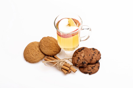 vin chaud: Glass of delicious glintwein or mulled hot wine, cinnamon and oatmeal cookies isolated on white background