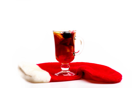 vin chaud: Glass of delicious glintwein or mulled hot wine with Santa Claus red sock isolated on white background, side view