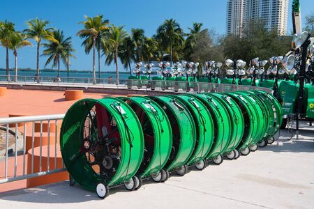 Miami, USA - February 29, 2016: mobile industrial fans equipment or tools with blade on wheels at exposure or trade show outdoors on sunny day on cityscape