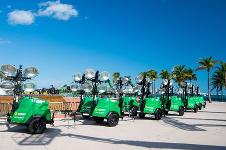 Miami, USA - February 29, 2016: mobile industrial equipment or tools for lighting on wheels at exposure or trade show outdoors on sunny day on blue sky
