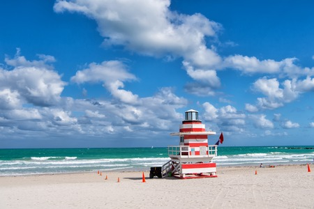florida house: South Beach, Miami, Florida, lifeguard house in a colorful Art Deco style on cloudy blue sky and Atlantic Ocean in background, world famous travel location