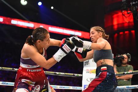 powerfull: Gdansk, Poland -September 17, 2016: boxing fight between Ewa Piatkowska and Aleksandra Magdziak Lopes for WBC Womens World Superwelterweight Championship Editorial