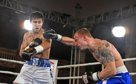 olimpiyskiy: Kyiv, Ukraine - December 24, 2016: An unidentified boxers in the ring during fight for ranking points in the NSC Olimpiyskiy, Kyiv, Ukraine