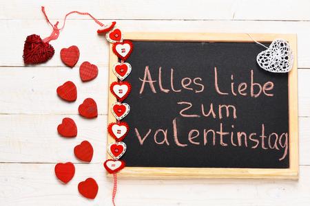Inscription Alles Liebe Zum Valentinstag Painted By Pink Chalk With  Valentine Decoration On Black Board On