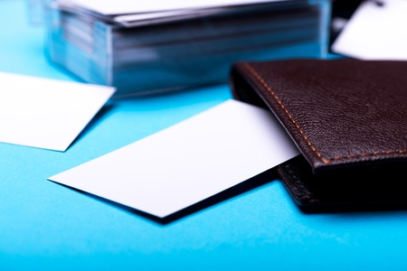 blanks: set of stationery for office: box with blanks, wallet, on blue background, side view, selective focus