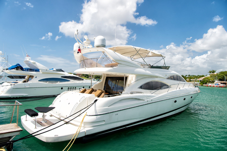 luxury yachts docked in the port in bay at sunny day with clouds on blue sky in La Romana, Dominican Republic Stock Photo