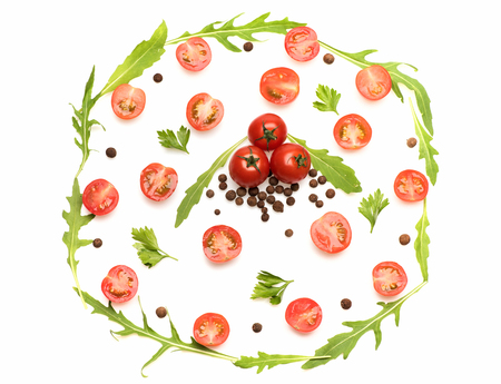 fresh vegetable, allspice, green arugula, cut cherry tomato red color isolated on white background