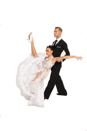 beautiful ballroom dance couple in a dance pose isolated on white background. sensual proffessional dancers dancing walz, tango, slowfox and quickstep