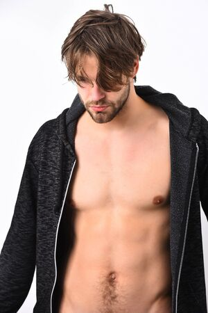 black sweater: Caucasian young macho with stylish hair, moustache shows muscular torso in black sweater isolated on white studio background Stock Photo