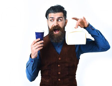caucasian hipster with moustache holding lunch box, cup of coffee with happy face isolated on white background
