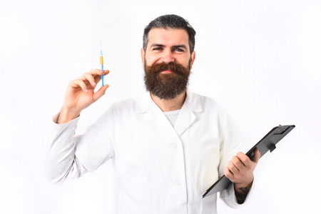 caucasian smiling happy doctor or unshaven hipster, postgraduate student holding clipboard with syringe in gown isolated on white studio background.