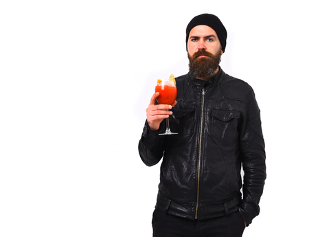 Bearded man, long beard. Brutal caucasian hipster with moustache holding glass of alcoholic beverage or fresh cocktail in rock black style isolated on white studio background
