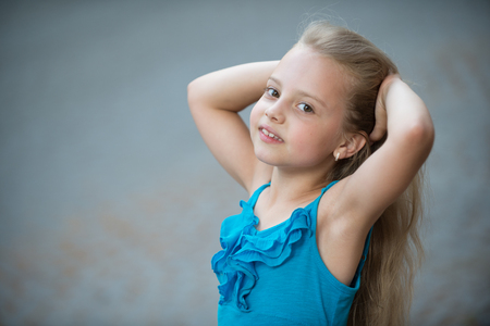 small baby girl or cute happy child with adorable smiling face and blonde hair in blue dress in summer outdoor on blurred background, copy space Фото со стока - 75145097