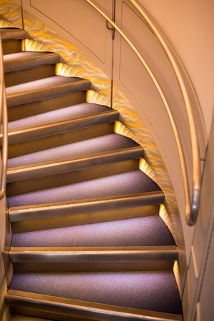 round stairs or ladder, step curling with handrail, modern architecture of tower or home building