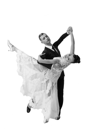 beautiful ballroom dance couple in a dance pose isolated on white background. sensual professional dancers dancing walz, tango, slowfox and quickstep, black and white