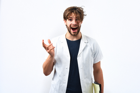 postgraduate: Bearded man, long beard. Brutal caucasian surprised happy doctor or unshaven hipster, postgraduate student holding clipboard in medical gown isolated on white background. Medicine concept