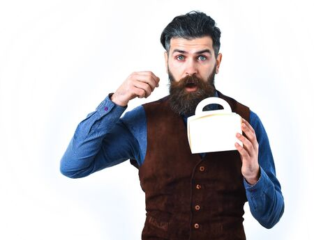 haircut: bearded man, long beard, brutal caucasian hipster with moustache holding lunch box with surprised face isolated on white background