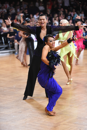 grand slam: Stuttgart, Germany - August 14, 2015: An unidentified dance latin couple in a dance pose during Grand Slam Latin at German Open Championship, on August 14, in Stuttgart, Germany Editorial