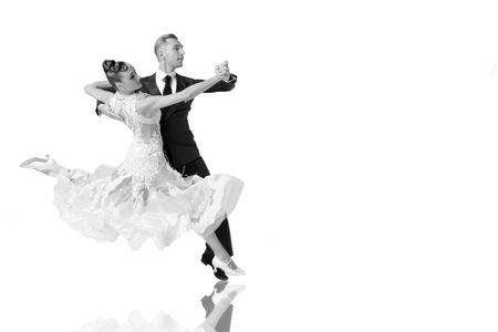 beautiful ballroom dance couple in a dance pose isolated on white background. sensual proffessional dancers dancing walz, tango, slowfox and quickstep, black and white Stock fotó - 79698334