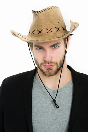 cowboy beard: businessman or young man wearing cowboy hat and black jacket isolated on white background