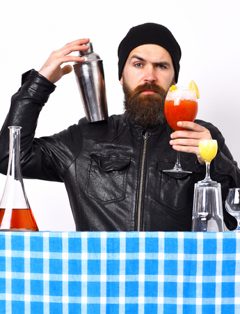 Bearded man, long beard. Brutal caucasian hipster with moustache in rock black style holding shaker or fresh cocktail and bar stuff with alcohol shot on blue checkered plaid isolated on white 版權商用圖片