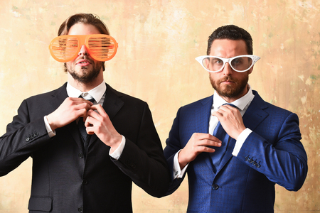 Team work concept. Serious lawyers celebrating successful in office in suits and funny glasses