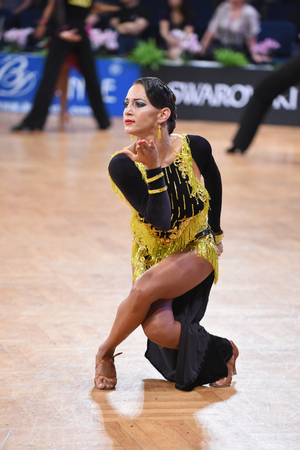 Stuttgart, Germany - August 14, 2015: An unidentified latin female dancer in a dance pose during Grand Slam Latin at German Open Championship, on August 14, in Stuttgart, Germany Editorial