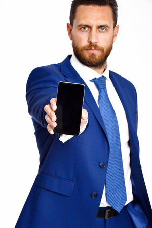 man with phone, businessman in formal outfit blue color with serious face isolated on white background, copy space